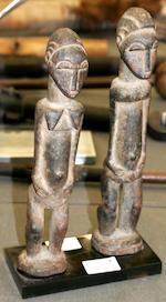 A pair of a Baule Asye Usu figures, Ivory Coast, 28cm and 27cm high repectively 2