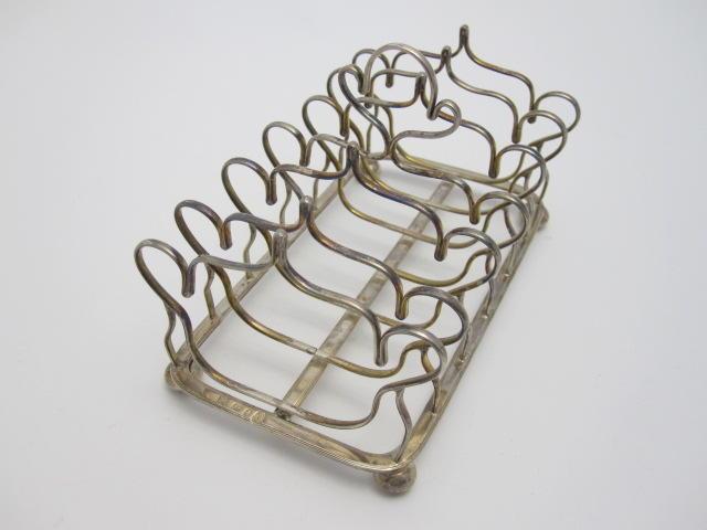 A George III silver toast rack By George Eadon & Co, Sheffield 1810