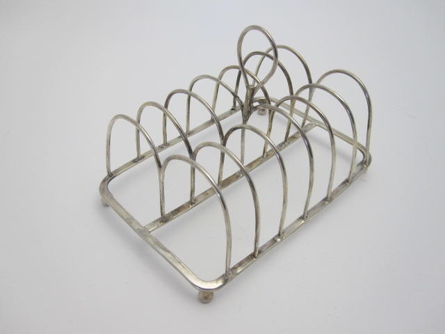 A George III silver toast rack Maker's mark rubbed, London 1796
