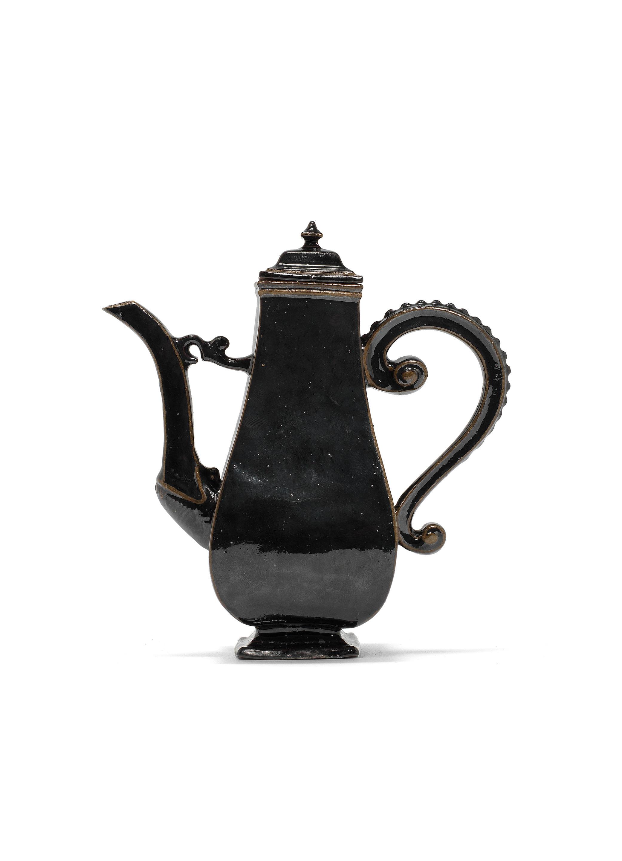 A Meissen black-glazed Böttger stoneware coffee pot and cover, circa 1710-13
