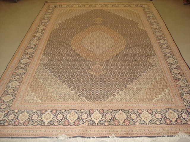 A Tabriz carpet, North West Persia, 297cm x 202cm