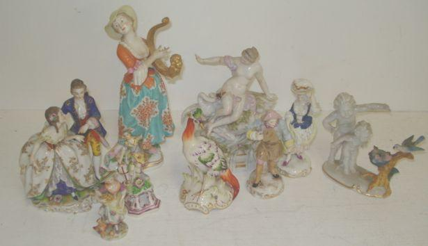 A Chelsea style porcelain figure of a young lady, playing a lyre, 26cm, figure of an exotic bird in Chelsea style, Meissen style figure of Leda and the swan, pair of Meissen style figures, she carrying a tray on her head, gilt scrollwork bases, German group of a gallant and his lady, Naples figure of a girl feeding a chicken, figure of Batannia on a spreading open work concave sided plinth base, and a figure of two putti gazing at birds and nest. (9)