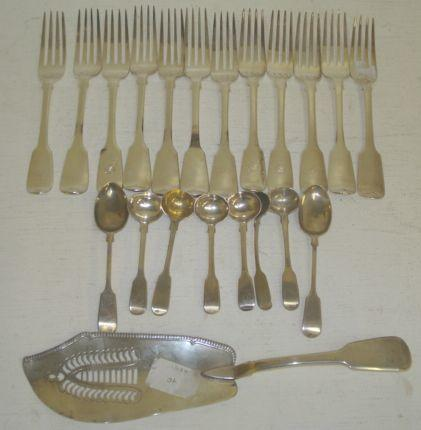 A set of six William IV silver fiddle pattern table forks, Mary Chawner, 1836, and six others, varying dates and makers, a similar George III fish slice, makers mark unclear, 1813, with gadroon edge, six similar salt spoons, three x 1834 and a pair of similar teaspoons, 35ozs. (21)