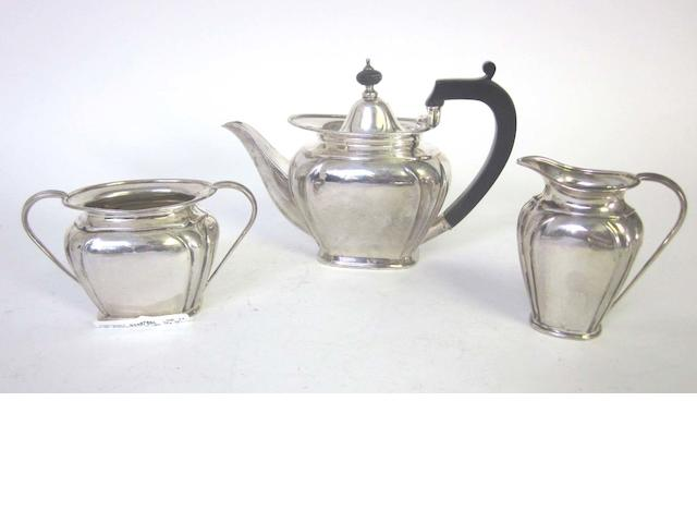 A silver three-piece bachelor's tea service, by Roberts & Belk, Sheffield 1915,  (6)