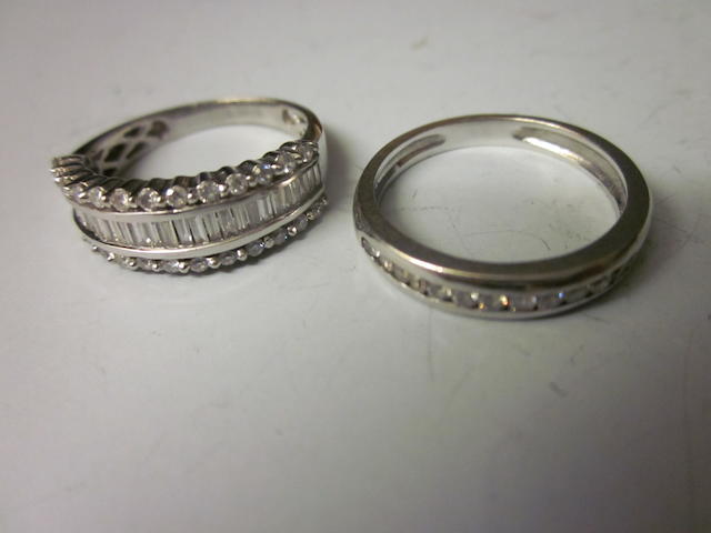 A diamond set eternity ring, (2)