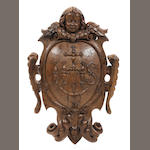 A Franco-Flemish carved oak wall cartouche, late 17th/early 18th century