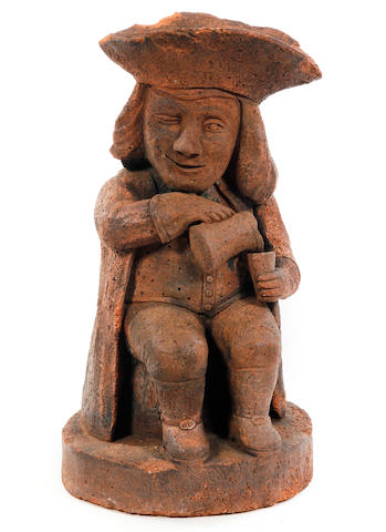 A large terracotta 'Toby' figure