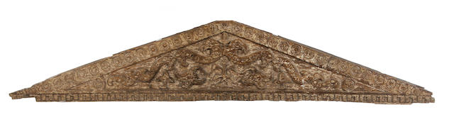 A carved and painted oak pediment
