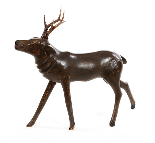 A polychrome-painted model of a stag