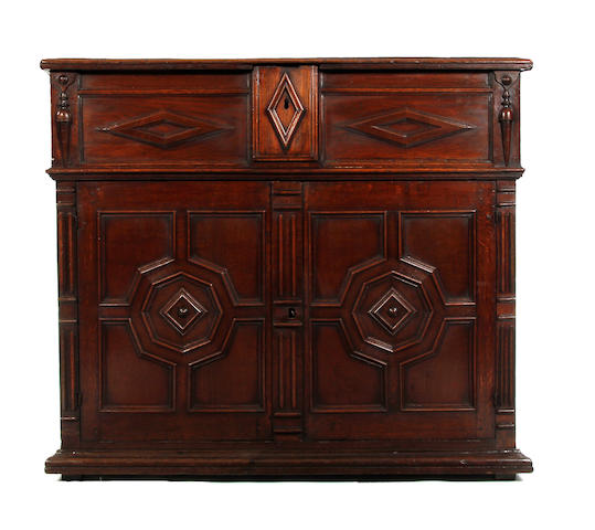 A Charles II oak enclosed chest of drawers With secret side drawers