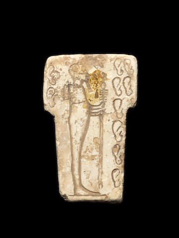 An Egyptian limestone 'ear stele'