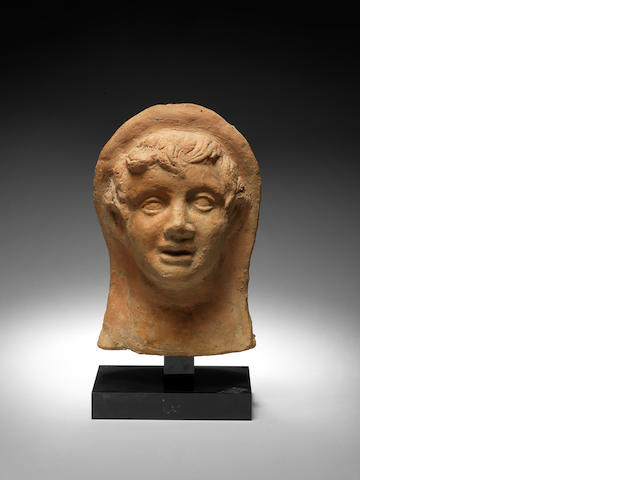 An Etruscan terracotta votive head