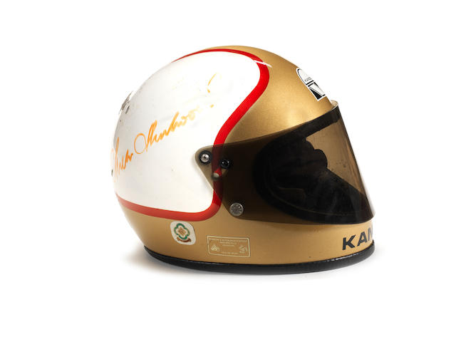 A signed Mike Hailwood Replica helmet, by Kangol,