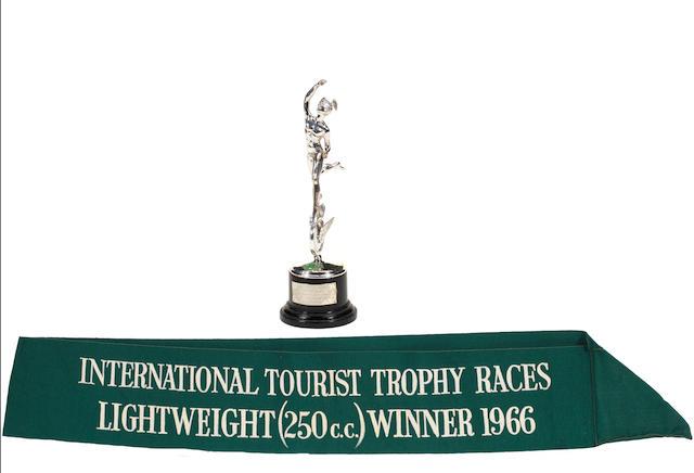 Mike Hailwood's 1966 Isle of Man TT winning Silver Replica Trophy and winner's sash,