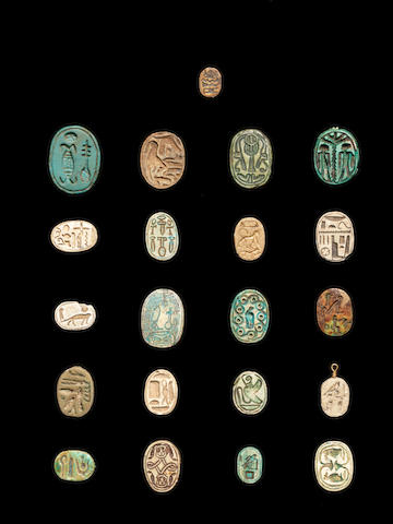Eighteen Egyptian steatite and glazed composition scarabs and three others, 21