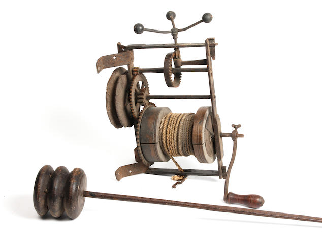 An 18th century wrought iron weight-driven spit jack