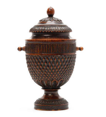 A Victorian turned beech lidded urn and cover, probably a tobacco jar