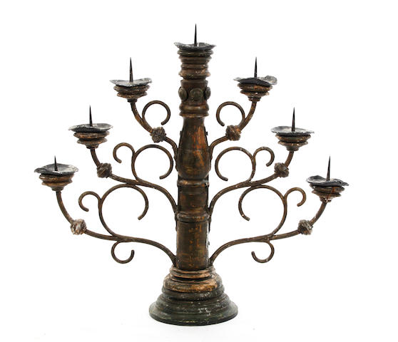 A polychrome-painted wooden six-branch candelabrum