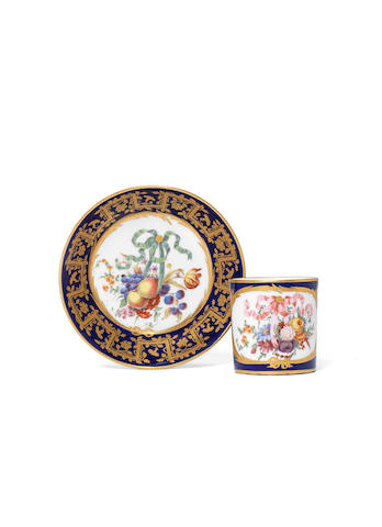 A Blue-ground Sèvres cup and saucer with flowers and fruit, for research