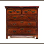 A George II oak and inlaid chest of drawers