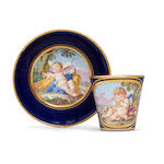 A Sèvres coffee can and saucer, circa 1780, painted with allecorical putti symbolising Summer and Autumn