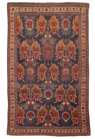 A Bidjar rug, Persian Kurdistan, circa 1900, 6 ft 10 in x 4 ft 4 in (199 x 133 cm) low pile, wear, scattered restoration