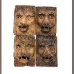 A set of four carved oak lion's head mounts Probably late Mediaeval