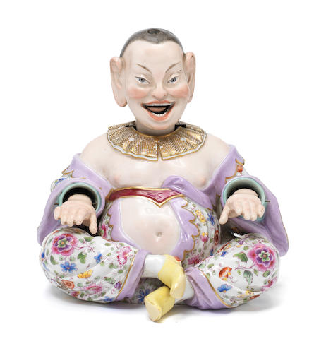 A 19th century Meissen polychrome porcelain pagoda figure of a seated Chinamen, decorated in typical colours with articulated nodding head and hands, signed to base with blue crossed swords and with incised mark # 156 -  Height 18cms
