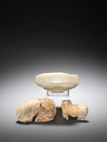 A Mesopotamian alabaster bowl and two Mesopotamian stone amulets, 3