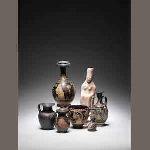 Six Greek terracotta vessels and a terracotta figure 7
