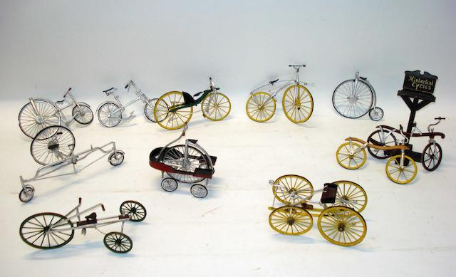 Eleven hand built scale models of early bicycles, mid twentieth century,