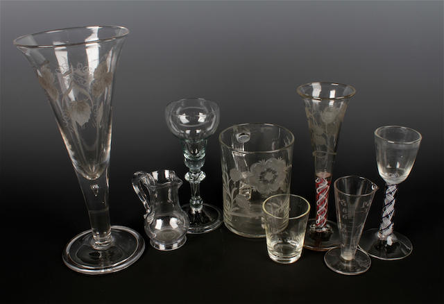 A Jacobite engraved mug, a Dutch engraved Jacobite glass, a cream jug and five other glasses, 18th century and later