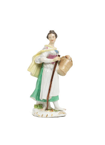 A Meissen figure of a lady with a bucket, circa 1755 (some restoration)