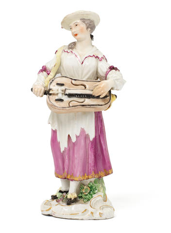 A Meissen figure of a female beggar musician, circa 1770 (minor damage)