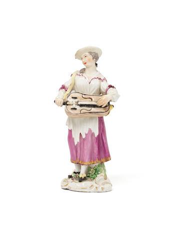 A Meissen figure of a female beggar musician, circa 1770 (minor damage)