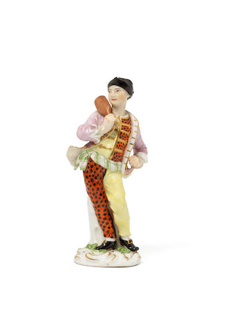 A Meissen figure of a boatman, circa 1755, the decoration later
