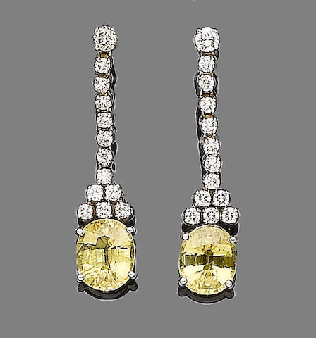 A pair of yellow sapphire and diamond pendent earrings