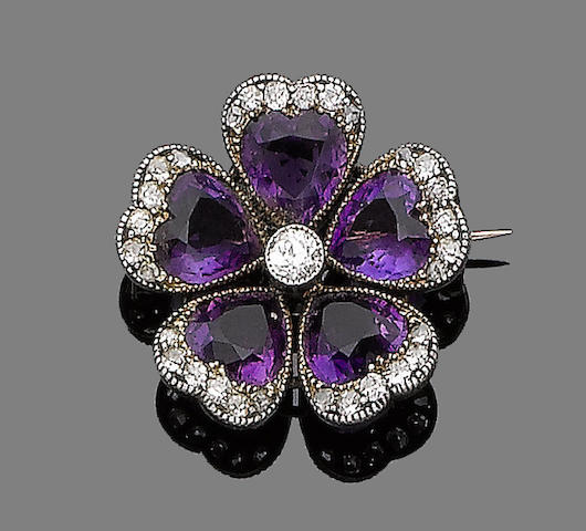 An amethyst and diamond-set pansy brooch,