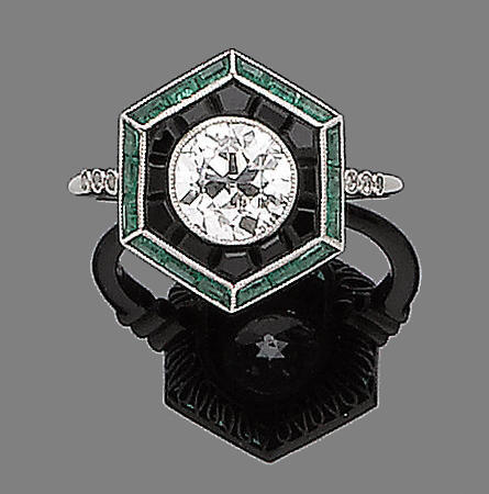 An onyx, emerald and diamond ring