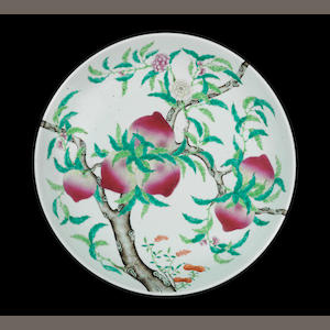 A Chinese mid XIX Century white dish with 9 peaches size aproximately 45cm radio