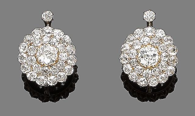 A pair of diamond cluster earrings