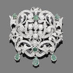 An emerald and diamond pendant/brooch,
