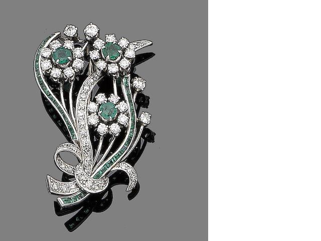 An emerald and diamond floral brooch