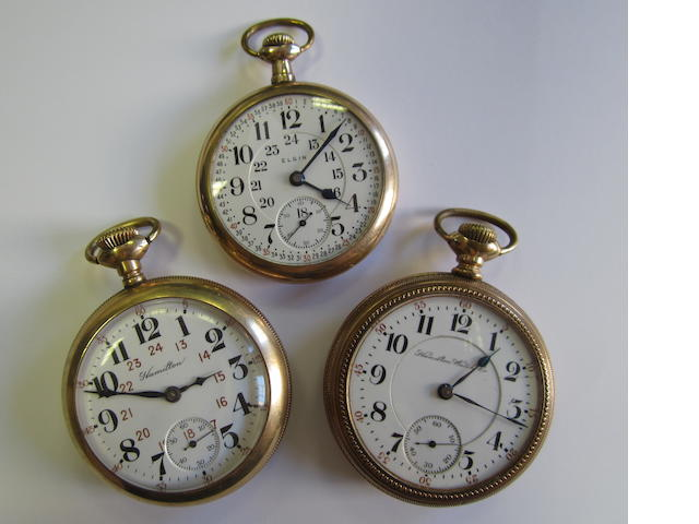 A lot of three gilt metal open face manual wind pocket watches