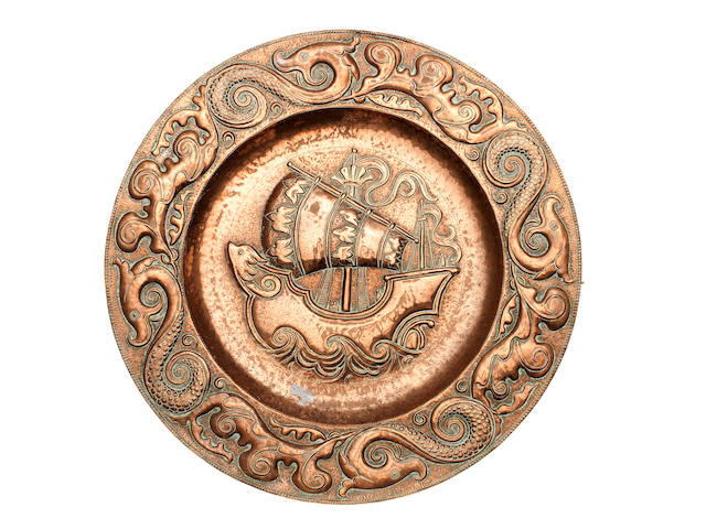 John Pearson  A Large Embossed Arts and Crafts Copper Charger, 1895