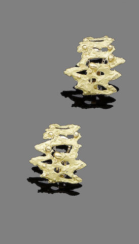 A pair of gold earclips, by Cartier,