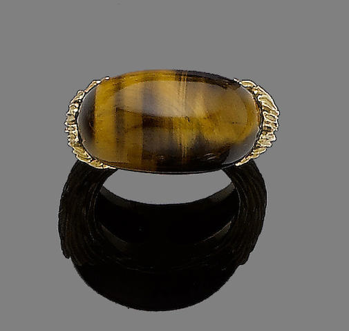A tiger's eye and gold ring,