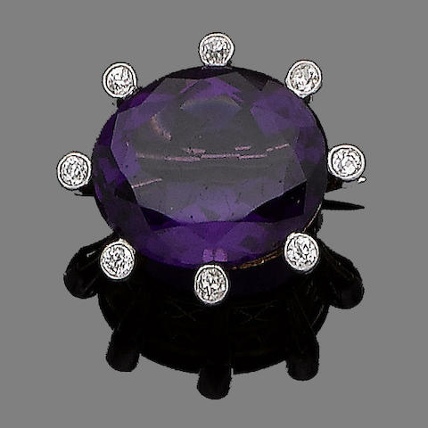 An amethyst and diamond brooch,