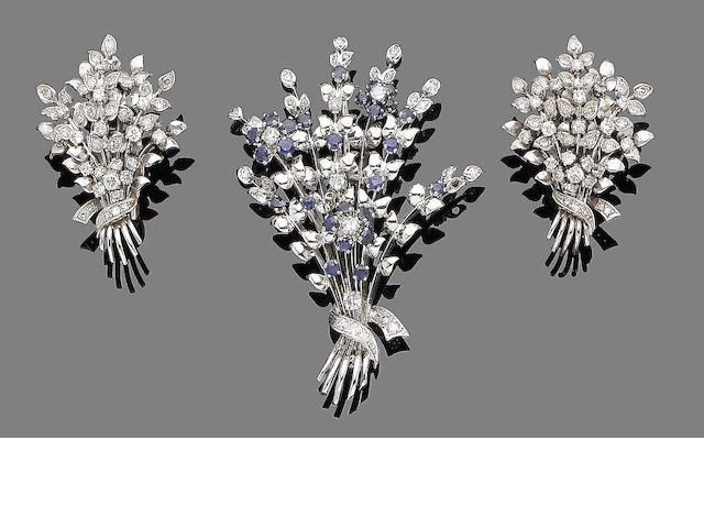 A pair of diamond flower earclips and a sapphire and diamond flower brooch (2)