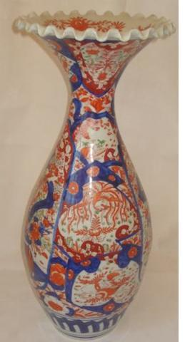 An early 20th century Imari porcelain vase, of baluster shape with narrow neck and scalloped rim, decorated in typical colours, 58cm.